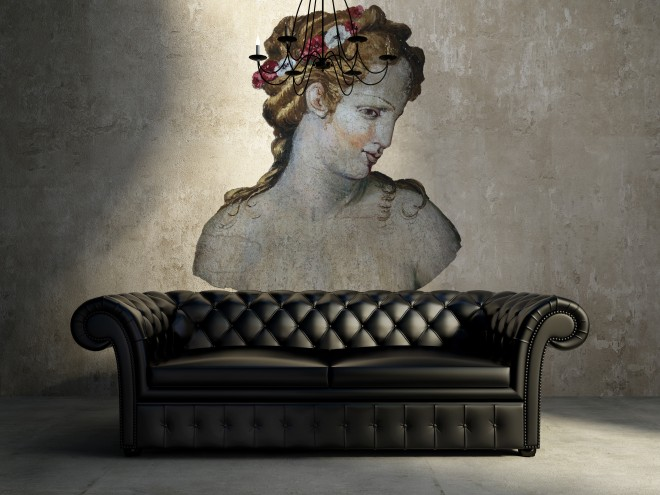 Vintage antique tufted modern classic black sofa, grunge wall